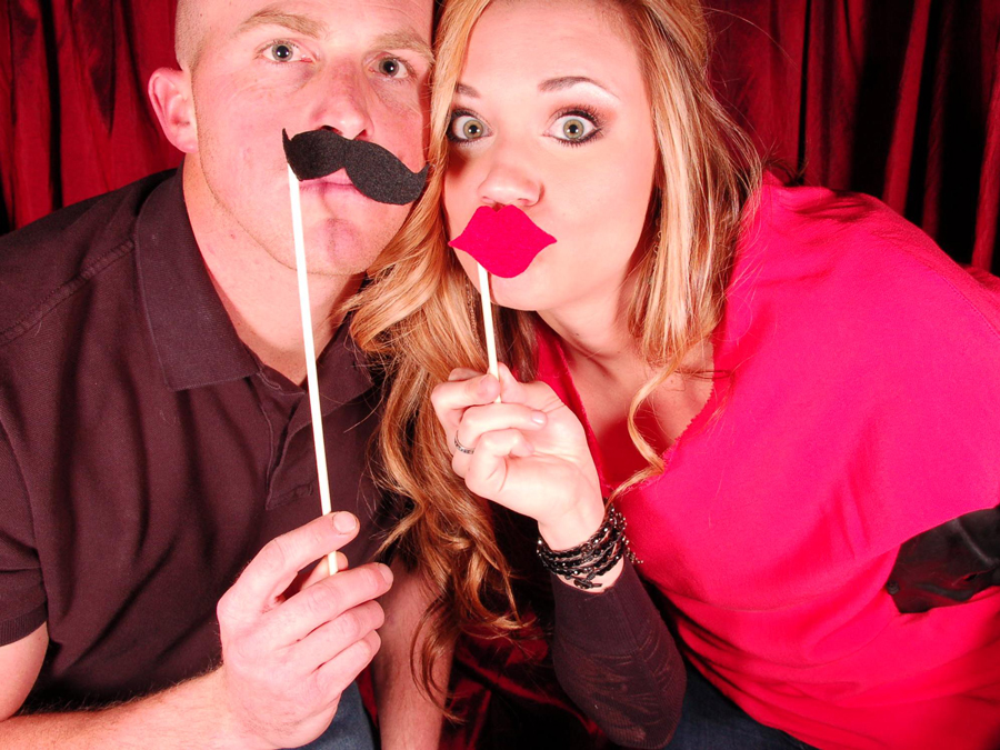 couple with DIY photobooth props