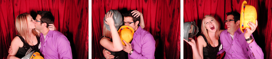 couple kissing in photobooth